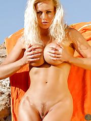 Sasha Sea shows boobs outdoor at the beach