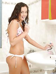 Brushing her teeth in the bathroom Kate Lynn feels horny..