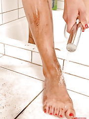 Mandy Dee washing her dirty feet