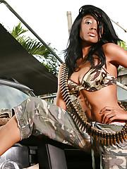 Ebony chick Nina demonstrates her big guns in uniform