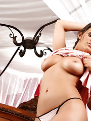 Hot brunette, Charlie Chase, strips out of her pink..