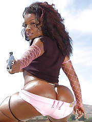 Outdoor posing from Candace Jai with a gun