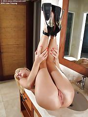 Long legged blonde model Niki Lee Young posing