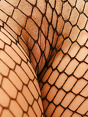 Wearing a full fishnet bodysuit Eva is letting it all hang..