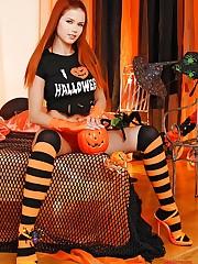 Kami is posing in her Halloween set