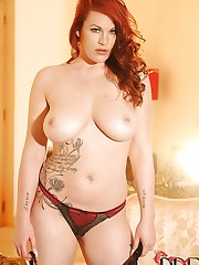 Busty redhead stripping for us!