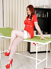 Buxom redhead Paige in hot latex!
