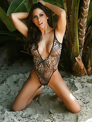 Exotic Alluring vixen Leila shows off her curves in a skin..