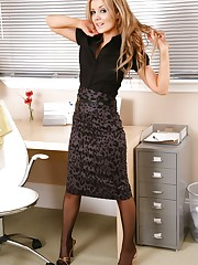 Stunning Faye teases her way out of a black blouse and..