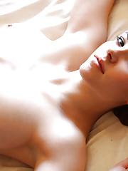 Big tits redhead Katlynn poses nude in close up