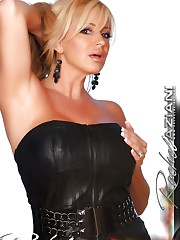 Naughty busty blonde, Rachel Aziani, poses in her black..