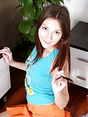 Teen Kattie Gold flaunts her perky tits and plays with her..