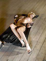 Blonde girl Jenny Mcclain poses in her high-heels