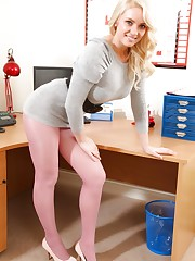 Sexy blonde in grey dress and pink tights