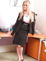 Michelle X in a sexy black skirt suit and pink blouse with..