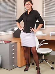 Beatiful dark haired secretary strips out of her office..