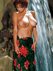 cools herself off at a waterfall