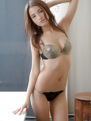 Stunning Nubile strips down to give you a taste of her..