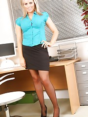 Saucy, blonde secretary shows off her sensational curves..