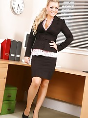 Sexy secretary strips after a long, hard day in the office.