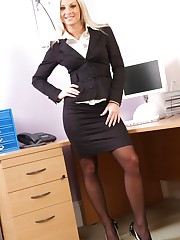 Tammy looks smart and sexy in her black skirt suit.
