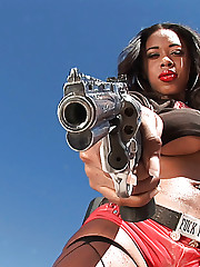 Black porn model Amber Fox plays with her guns