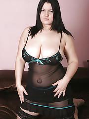 Kim B strips to reveal her big 34GG juggs