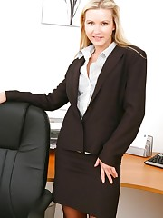 Breathtaking blonde secretary in smart black skirt suit.