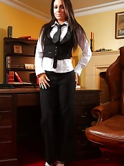Stunning brunette in black trousers, a wasitcoat and tight..