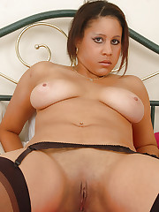 Desiree playing with her juggs and pussy