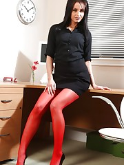 Raven haired secretary pleases her boss by slipping out of..