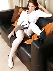 Laura in white suspenders and tight blouse
