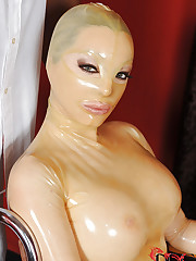 Latex babe enjoys the fuck machine