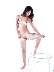 Angelic petite model fucks her creamy pussy with a dildo..