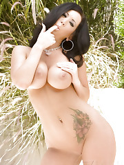 Beautiful busty, Jayden Jaymes, poses outside in her tiny..