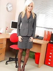 Pretty Paige D looks gorgeous in her smart grey skirt suit..