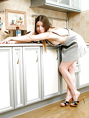 Amazing teen in the kitchen posing with an upskirt view of..