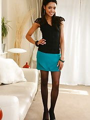 Stunner Natasha looking hot wearing a green miniskirt and..