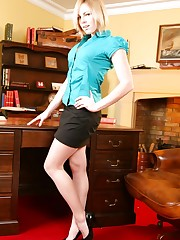 Cheeky blonde secretary slips out of her office clothes and..