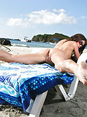 Whore masturbates on the beach