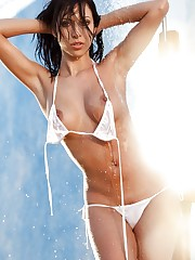 gets wet and takes off her white bikini