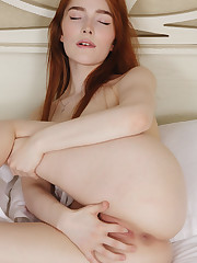 Jia Lissa satisfies her pink, wet cunt with her fingers