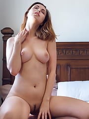 Nasita displays her luscious body as she strips on the bed.