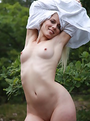 Sandik A sensually poses outdoors baring her natural beauty.