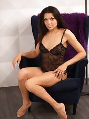Isha sensually strips on the couch baring her sweet pussy.
