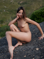 Antea playfully poses outdoors baring her fully nude body.