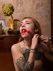 Marcella Lippy bare her tattooed body as she masturbates..