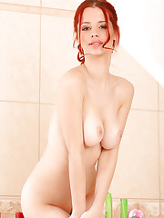 big tit redhead taking a shower