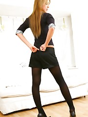Sexy blonde in black miniskirt and pantyhose.