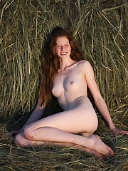 Nicole K poses on the grass field as she flaunts her..